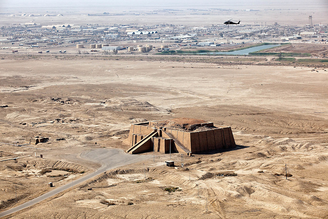 SOUTHERN IRAQ 18 AUGUST 2010:  The Ziggurat of Ur and the reputed birthplace od Abraham, a 4000 year old structure  near Nasiriyah in the present-day Dhi Qar Province, Iraq is located on the very edge of Contingency Operating Base Adder airbase (at rear) in Southern IraqThe members of the 4/2 Strykers Brigades passed nearby in a convoy en-route to the Kuwait border where they will be packing up and heading back to the USA.  Iraq is preparing after US President Barack Obama has confirmed the end of all combat operations in the country by 31 August..Some 50,000 of 65,000 US troops currently in Iraq are set to remain until the end of 2011 to advise Iraqi forces and protect US interests.The remaining 50,000 troops will stay in the country in order to train Iraqi security forces, conduct counterterrorism operations and provide civilians with ongoing security, said Mr Obama..An agreement negotiated with the Iraqis in 2008 states that these troops must be gone from the country by the end of next year. pic Graham Crouch/The Guardian