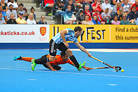 Argentina's Facundo Callioni and Malaysia's Najmi Jazlan compete for the ball during the Hockey World League Semi-Final match between Argentina and Malaysia at the Olympic Park, London, England on 24 June 2017. Photo by Steve McCarthy.