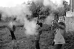 Tar Barrel Rolling. Ottery St Mary, Devon, England  1973. Firing rock cannons. Small gun like instruments. Annually November 5th.