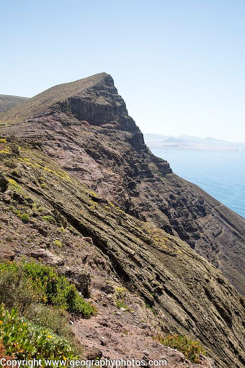 Steep coastal cliffs Risco de Famara looking south from Guinate, Lanzarote, Canary Islands, Spain