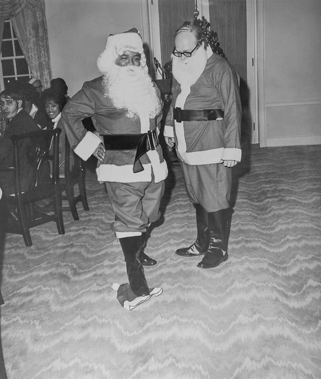 George, the bartender had a fight with the other Santa Claus, Bill Mariott and stamps in his hat when he mussled in his territory. (Photo by Mickey Senko/CQ Roll Call via Getty Images)