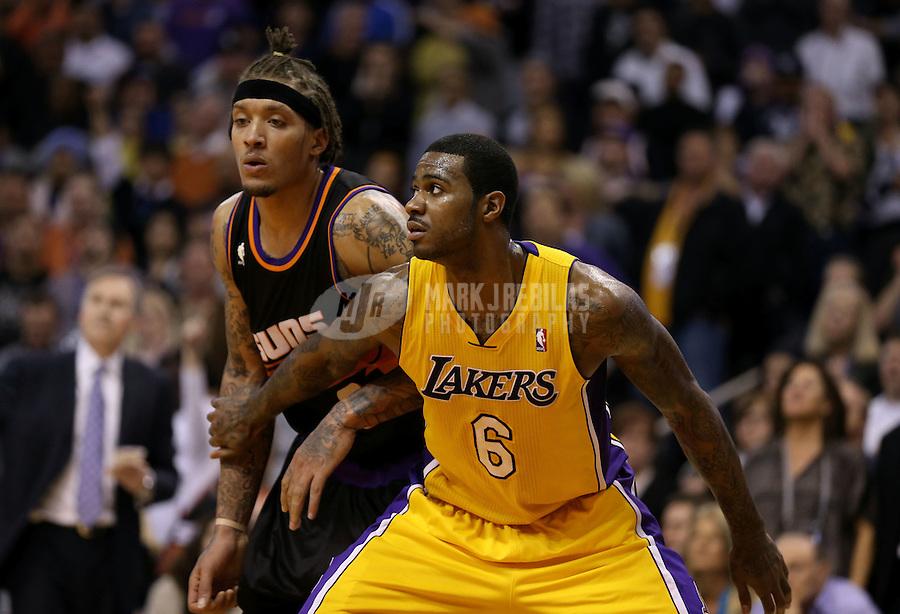 Jan. 30, 2013; Phoenix, AZ, USA: Los Angeles Lakers forward Earl Clark (6) against Phoenix Suns forward Michael Beasley at the US Airways Center. Mandatory Credit: Mark J. Rebilas-