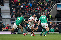 Twickenham, United Kingdom.  Jonathan JOSEPH, going for the gap between, [L] Bundee AKI and [R] Garry RINGROSE, during the Natwest 6 Nations Rugby Match, England vs Ireland. at the  RFU Stadium, Twickenham, England, <br />