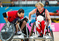 18 APR 2012 - LONDON, GBR - Canadian Garett Hickling (CAN) (Class 3.5) (right) attempts to avoid a challenge from Great Britain's Ross Morrison (GBR) (Class 2.5) (left) during their London International Invitational Wheelchair Rugby Tournament match at the Olympic Park Basketball Arena in Stratford, London, Great Britain (PHOTO (C) 2012 NIGEL FARROW)