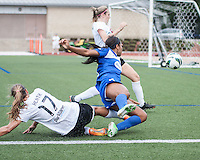 In a National Women's Soccer League Elite (NWSL) match, Portland Thorns FC defeated the Boston Breakers, 2-1, at Dilboy Stadium on July 21, 2013.  Portland Thorns FC midfielder Tobin Heath (17) and Boston Breakers defender Jazmyne Avant (5) collide near the Thorns' goal line.