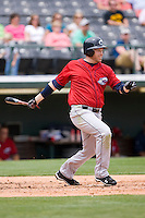 Jordan Brown #9 of the Columbus Clippers follows through on his swing against the Charlotte Knights at Knights Stadium May 25, 2010, in Fort Mill, South Carolina.  Photo by Brian Westerholt / Four Seam Images