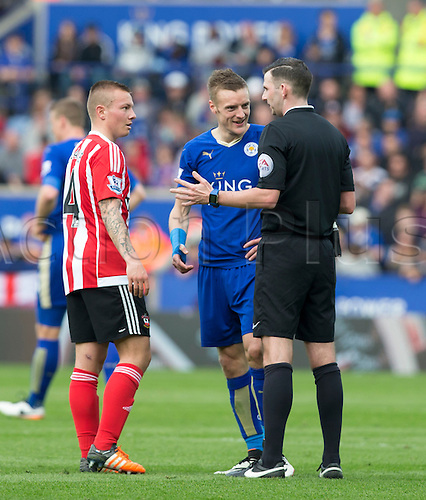 03.04.2016. King Power Stadium, Leicester, England. Barclays Premier League. Leicester versus Southampton. Referee Mr. Michael Oliver has a word with Southampton midfielder Jordy Classy and Leicester City striker Jamie Vardy after a foul and tempers raised.