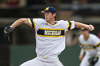 Michigan Wolverines pitcher Evan Hill (21) delivers a pitch to the plate during the NCAA baseball game against the Washington Huskies on February 16, 2014 at Bobcat Ballpark in San Marcos, Texas. The game went eight innings, before travel curfew ended the contest in a 7-7 tie. (Andrew Woolley/Four Seam Images)