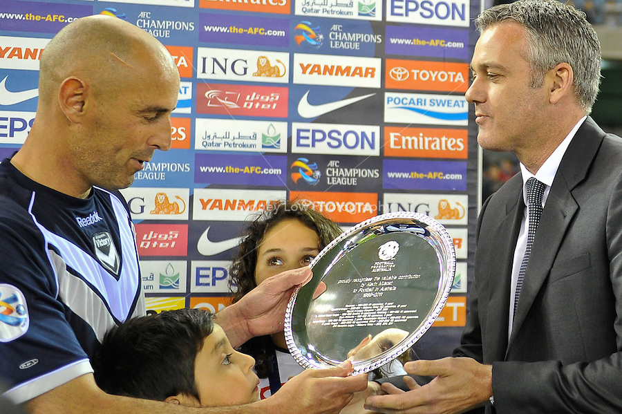 MELBOURNE, AUSTRALIA - MAY 4, 2011: Kevin Muscat being presented with a plate by Ben Buckley of the Football Federation Australia after the AFC Champions League Group E match between Melbourne Victory and Gamba Osaka at Etihad Stadium on May 4, 2011 in Melbourne, Australia. Photo Sydney Low / Asteriskimages.com