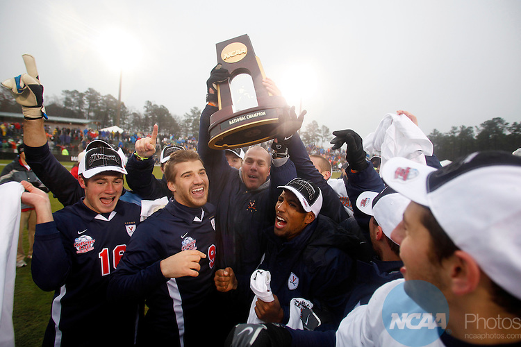 13 DEC 2009:  Head Coach George Gelnovatch of the University of Virginia holds up the trophy after defeating the University of Akron during the Division I Men's Soccer Championship held at the WakeMed Soccer Park in Cary, NC.  Virginia defeated Akron 3-2 on penalty kicks in a shootout to win the national title.  Jamie Schwaberow/NCAA Photos