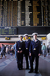 Riga Latvia 1980s  A Baltic State country part of the USSR.  Three young male sailors in their uniform look up at a railway train notice board Central railway station 1989.