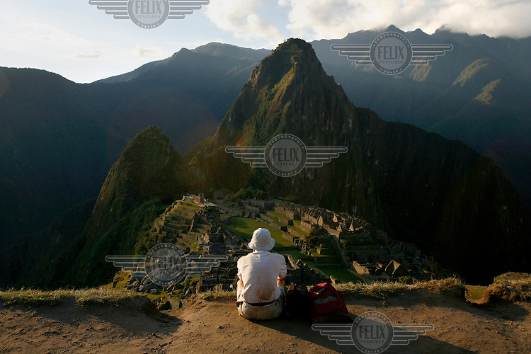 A tourist looks down onto the mountain top site of Machu Picchu, the so-called 'Lost City of the Incas'.