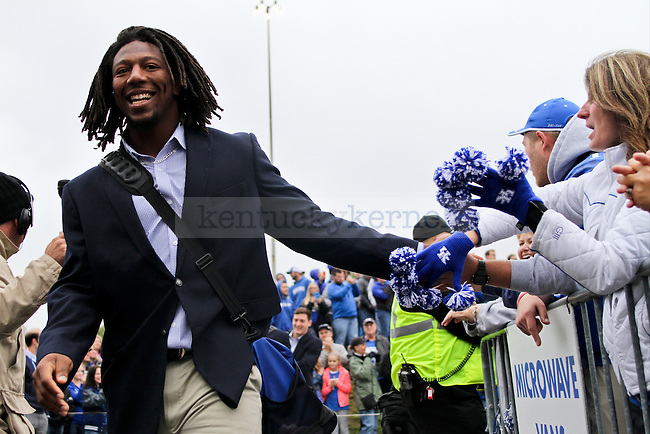 """Kentucky defensive end Alvin """"Bud"""" Dupree high fives fans while the UK men's football team arrives at Commonwealth Stadium in Lexington, Ky., on Saturday, October 11, 2014. Photo by Jonathan Krueger 
