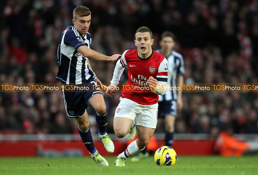Jack Wilshere of Arsenal and James Morrison of West Brom - Arsenal vs West Bromwich Albion, Barclays Premier League at The Emirates Stadium, Arsenal - 08/10/12 - MANDATORY CREDIT: Rob Newell/TGSPHOTO - Self billing applies where appropriate - 0845 094 6026 - contact@tgsphoto.co.uk - NO UNPAID USE.