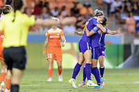 Houston, TX - Saturday June 17, 2017: Alanna Kennedy celebrates with her teammates after scoring a goal against Houston during a regular season National Women's Soccer League (NWSL) match between the Houston Dash and the Orlando Pride at BBVA Compass Stadium.
