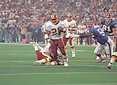 Washington Redskins running back Earnest Byner (21) carries the ball against the Buffalo Bills during Super Bowl XXVI in Minneapolis, Minnesota on January 26, 1992.  The Redskins won the game and the World Championship 37 - 24.<br /> Credit: Howard L. Sachs / CNP