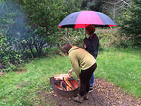 Desperate attempt to start a campfire in a rain storm, Sunset Bay State Park, Oregon Coast