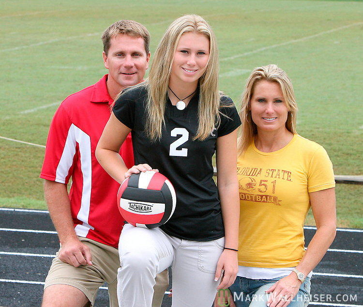 The Weldons, Casey, left, daughter Kendall, center, and wife Lori on the NFC football field.(Mark Wallheiser/TallahasseeStock.com)