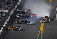 Feb 10, 2007; Daytona, FL, USA; Nascar Nextel Cup drivers Denny Hamlin (11) Elliott Sadler (19) and Dale Earnhardt Jr (8) crash on the last lap during the Budweiser Shootout at Daytona International Speedway. Mandatory Credit: Mark J. Rebilas