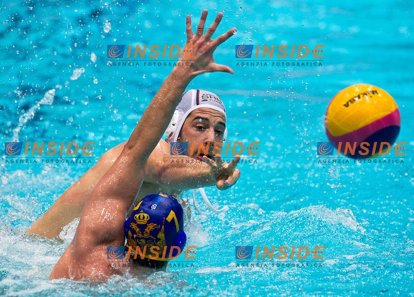 Eindhoven , Netherlands (NED) 23/1/2012.LEN European  Water Polo Championships 2012.Day 08 - Men.Serbia (White) - Montenegro (Blue)..SRB.1 SORO Slobodan.2 SAPONJIC Aleksa.3 GOCIC Zivko.4 UDOVICIC Vanja.5 CUK Milos.6 PIJETLOVIC Dusko.7 NIKIC Slobodan.8 ALEKSIC Milan.9 RADJEN Nikola.10 FILIPOVIC Filip.11 PRLAINOVIC Andrija.12 MITROVIC Stefan.13 MITROVIC Branislav..MNE.1 RADIC Zdravko.2 BRGULJAN Drasko.3 PASKOVIC Vjekoslav.4 PETROVIC Antonio.5 KLIKOVAC Filip.6 RADOVIC Aleksandar.7 JANOVIC Mladan.8 JANOVIC Nikola.9 IVOVIC Aleksandar.10 ZLOKOVIC Boris.11 GOJKOVIC Vladimir.12 JOKIC Predrag.13 SCEPANOVIC Milos..Photo Insidefoto / Giorgio Scala