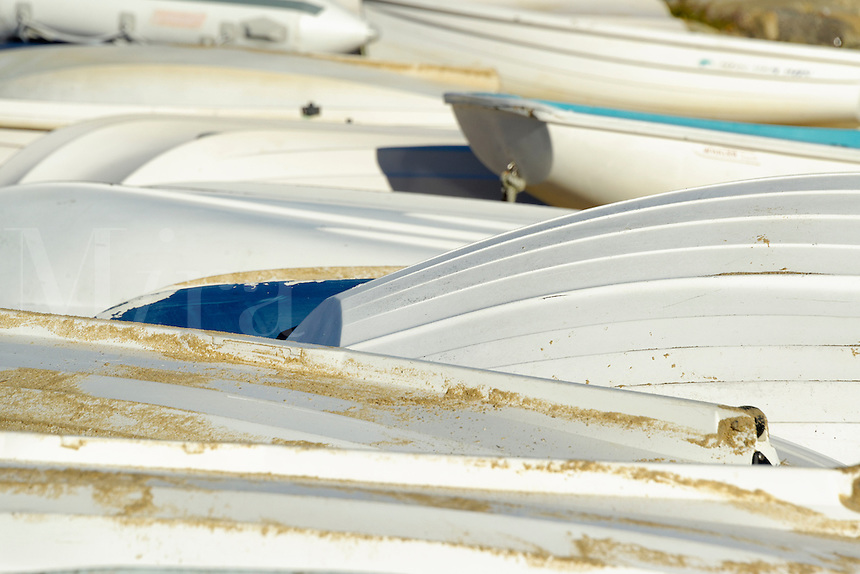 Overturned rowboats on the beach.