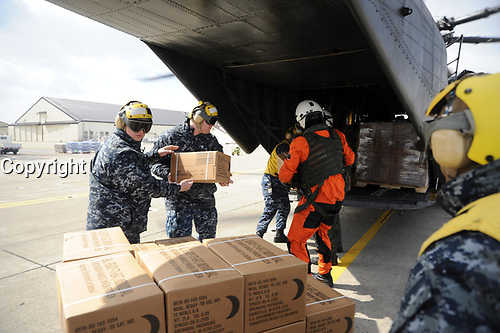 Navy Misawa sailors load Meals Ready to Eat onboard an MH-53E helicopter, from Helicopter Countermeasures Squadron 14. HM-14 personnel are conducting humanitarian assistance missions in Japan following a 9.0-magnitude earthquake that triggered a devastating tsunami along Japan's eastern coastline. HM-14 is currently operating onboard USS Tortuga in support of Operation Tomodachi. Operation Tomodachi (Japanese for 'Äsfriendship'Ät) involves 14 U.S. Navy ships, more than 100 aircraft and thousands of U.S. service members assisting with disaster relief and humanitarian development assistance.