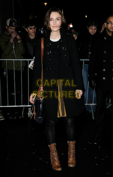 "KEIRA KNIGHTLEY .Departed after an evening performance of ""The Children's Hour"", The Comedy Theatre, London, England, UK, .2nd February 2011..full length brown boots black coat tights bag lace-up gold skirt .CAP/CAN.©Can Nguyen/Capital Pictures."