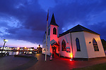 Marking 50 days to go to the Commonwealth Games the Norwegian Church in Cardiff Bay is lit up red to show its support for Team Wales.<br /> 23.06.14<br /> &copy;Steve Pope-SPORTINGWALES