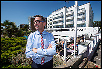 BNPS.co.uk (01202 558833)<br /> Pic: PhilYeomans/BNPS<br /> <br /> Cumberland Hotel manager Kevin Wood - 'Its a race for the sun loungers'<br /> <br /> The summer heatwave is leading to a 'bumper year' for tourism at Britain's premier seaside resort.<br /> <br /> Over 100,000 people are visiting Bournemouth, Dorset, every weekend and hotels are full to capacity, with restaurants packed and huge queues at ice cream stalls.<br /> <br /> Seafront kiosks are selling out of parasols and sun cream, while one bike hire company has reported a 50 per cent increase in business.