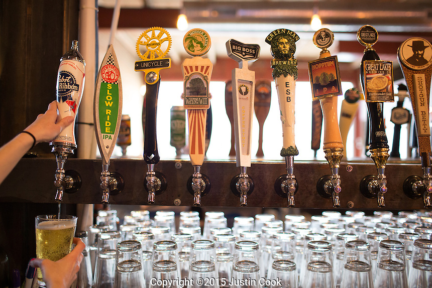 Local craft beers on tap at Boxcar Bar and Arcade in Raleigh, North Carolina on Thursday, January 22, 2015. (Justin Cook)