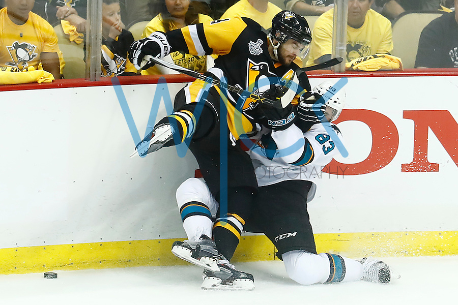 Chris Kunitz #14 of the Pittsburgh Penguins hits Matt Nieto #83 of the San Jose Sharks during game five of the Stanley Cup Final at Consol Energy Center in Pittsburgh, Pennsylvania on June 9, 2016. (Photo by Jared Wickerham / DKPS)