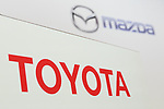 Logos of Toyota Motor Corporation and Mazda Motor Corporation on display during a news conference at the Royal Park Hotel Tokyo on August 4, 2017, Tokyo, Japan. Toyota Motor Corporation President Akio Toyoda and Mazda Motor Corporation President and CEO Masamichi Kogai, announced an alliance between the car makers; whereby they will invest in each other and plan to build a joint auto factory in the U.S. and cooperate in new technologies for electric vehicles.(Photo by Rodrigo Reyes Marin/AFLO)