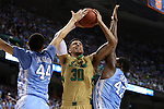 14 March 2015: Notre Dame's Zach Auguste (30) is guarded by North Carolina's Justin Jackson (44) and Joel James (42). The Notre Dame Fighting Irish played the University of North Carolina Tar Heels in an NCAA Division I Men's basketball game at the Greensboro Coliseum in Greensboro, North Carolina in the ACC Men's Basketball Tournament quarterfinal game. Notre Dame won the game 90-82.