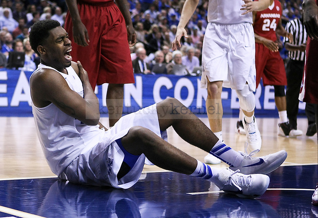 Kentucky center Dakari Johnson holds his shoulder after taking a hard hit during the second half of the Championship game of the SEC tournament against Arkansas in Nashville , Tenn., on Sunday, March 15, 2015. Photo by Jonathan Krueger | Staff