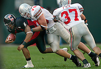 Ohio State's Simon Fraser, 75, tackles Bearcats Vann LaDaris, 6, during game action in the first quarter of their game at Paul Brown Stadium in Cincinnati, September 21, 2002. (Dispatch photo by Neal C. Lauron)