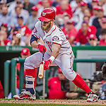 6 April 2015: Washington Nationals outfielder Bryce Harper attempts a bunt  in the 9th inning of the Home Opening Game against the New York Mets at Nationals Park in Washington, DC. The Mets rallied to defeat the Nationals 3-1 in their first meeting of the 2015 MLB season. Mandatory Credit: Ed Wolfstein Photo *** RAW (NEF) Image File Available ***