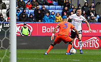Bolton Wanderers' Pawel Olkowski competing with Millwall's James Meredith <br /> <br /> Photographer Andrew Kearns/CameraSport<br /> <br /> The EFL Sky Bet Championship - Bolton Wanderers v Millwall - Saturday 9th March 2019 - University of Bolton Stadium - Bolton <br /> <br /> World Copyright © 2019 CameraSport. All rights reserved. 43 Linden Ave. Countesthorpe. Leicester. England. LE8 5PG - Tel: +44 (0) 116 277 4147 - admin@camerasport.com - www.camerasport.com