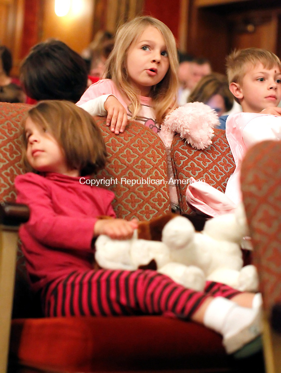 Torrington, CT-22 April 2012-042212CM08-  Rachel, 2, (front) Gabriel, Brooke 3, and Gabriel 5 Sullo of West Hartford wait patiently with their stuffed animals Sunday afternoon at Warner Theatre in downtown Torrington.  The trio were with family attending the Laurie Berkner Band who sings about various animals.  Patrons brought stuffed animals and dressed up in costumes.   Christopher Massa Republican-American