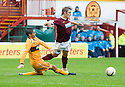 MOTHERWELL'S KEITH LASLEY GETS A SECOND YELLOW AND IS SENT OFF AFTER THIS LATE CHALLENGE ON HEARTS' ARVYDAS NOVIKOVAS