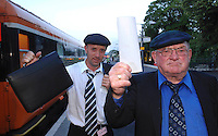 Armed with a document signed by Taosieach Bertie Ahern  and worth millions of euro for South Kerry, Deputy Jackie Healy-Rae and his son Michael are tired but ebullient after sarriving at Killarney Railway Station  on Monday night.<br />