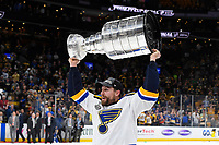 June 12, 2019: St. Louis Blues left wing David Perron (57) hoists the Stanley Cup at game 7 of the NHL Stanley Cup Finals between the St Louis Blues and the Boston Bruins held at TD Garden, in Boston, Mass.  The Saint Louis Blues defeat the Boston Bruins 4-1 in game 7 to win the 2019 Stanley Cup Championship.  Eric Canha/CSM.
