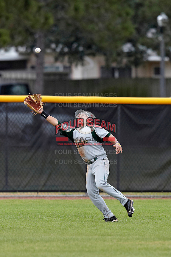 USF Bulls outfielder Alex Mendez #9 attempts to catch a fly ball during a game against the Ohio State Buckeyes at the Big Ten/Big East Challenge at Walter Fuller Complex on February 17, 2012 in St. Petersburg, Florida.  (Mike Janes/Four Seam Images)
