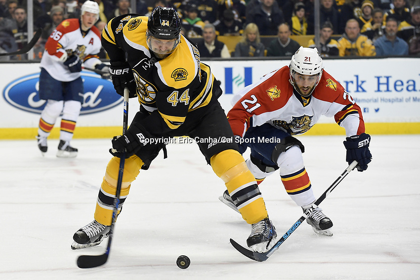 Thursday, March 24, 2016: Boston Bruins defenseman Dennis Seidenberg (44) and Florida Panthers center Vincent Trocheck (21) battle for control of the puck during the National Hockey League game between the Florida Panthers and the Boston Bruins held at TD Garden, in Boston, Massachusetts. Eric Canha/CSM