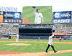 Hideki Matsui,<br /> JULY 28, 2013 - MLB :<br /> Hideki Matsui tips his cap to fans after throwing out the ceremonial first pitch as New York Yankees starting pitcher Phil Hughes is seen on the mound during Matsui's official retirement ceremony before the Major League Baseball game against the Tampa Bay Rays at Yankee Stadium in The Bronx, New York, United States. (Photo by AFLO)