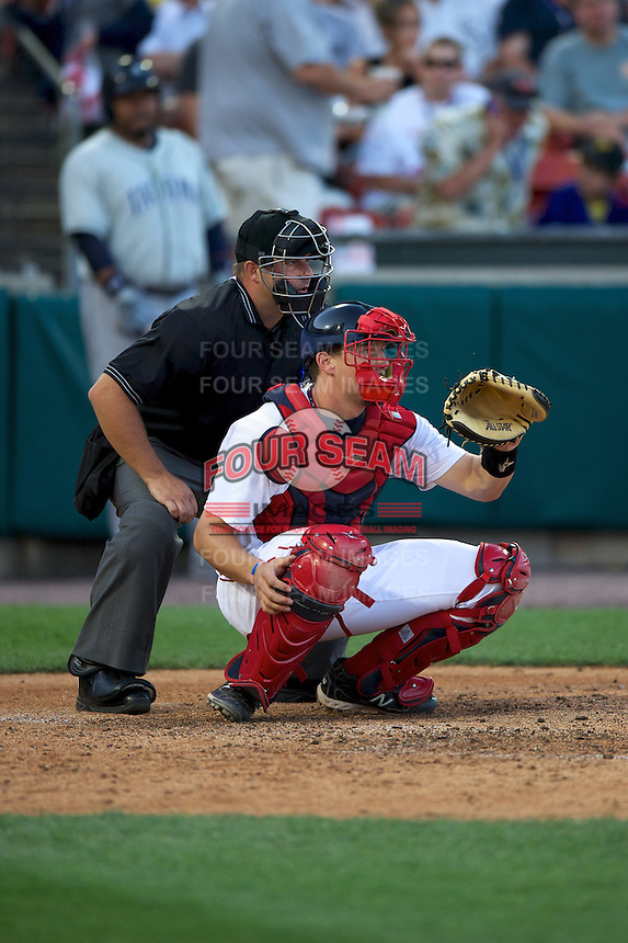 Pawtucket Red Sox catcher Ryan Lavarnway #36 and umpire Mark Lollo during the Triple-A All-Star game featuring the Pacific Coast League and International League top players at Coca-Cola Field on July 11, 2012 in Buffalo, New York.  PCL defeated the IL 3-0.  (Mike Janes/Four Seam Images)