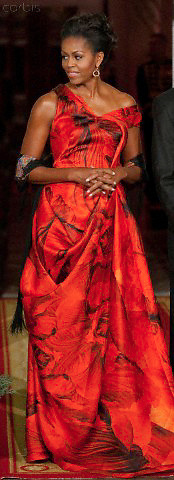 19 Jan 2011, Washington, DC, USA --- First lady Michelle Obama waits to greet Chinese President Hu Jintao for a state dinner at the White House in Washington.  Obama wore a deep red gown from Alexander McQueen's resort collection. The dress was designed by Sarah Burton, McQueen's protege and newly-installed creative director. --- Image by © Brooks Kraft/Corbis
