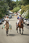Rodeo queens ride their horses. Downtown main street during the Independence Day celebration Main Street, Mokelumne Hill, California