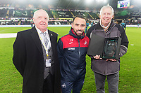 Leon Britton of Swansea City is presented with a commemorative award for 15 years of outstanding service to the club from the Supporters Trust prior to kick off of the Premier League match between Swansea City and Manchester City at the Liberty Stadium, Swansea, Wales, UK. 13 December 2017