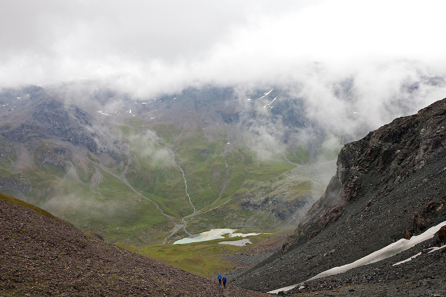 Descending from the Col du Tsate, along stage 9 of the Walker's Haute Route, between La Sage and Cabane du Moiry, Switzerland.
