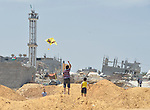 Boys fly a kite in Shejaiya, a neighborhood of Gaza City that was hard hit by the Israeli military during the 2014 war.
